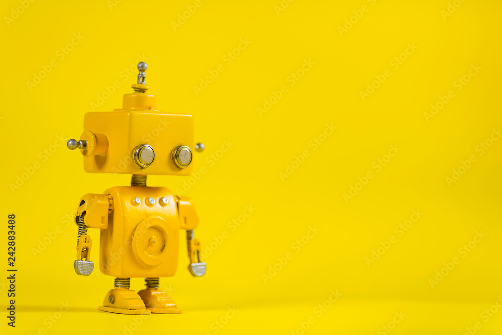 Fototapety, obrazy: Robot on a yellow background.