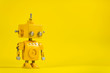 canvas print picture - Robot on a yellow background.