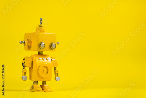 Photo  Robot on a yellow background.