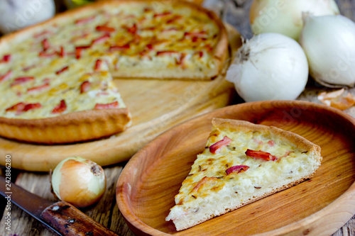 Traditional german onion cake zwiebelkuchen, onion pie with ham on thin dough