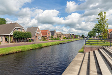 Dutch Village Appelscha In Friesland With Houses Along A Canal