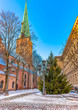 Church of Saint Jacob and Christmas tree near a building of Latvian parliament in Riga - the capital and largest city of Latvia, major cultural, historical and tourist center of Baltic region