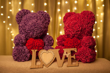 Bear Of Flowers With Heart At Bright Background