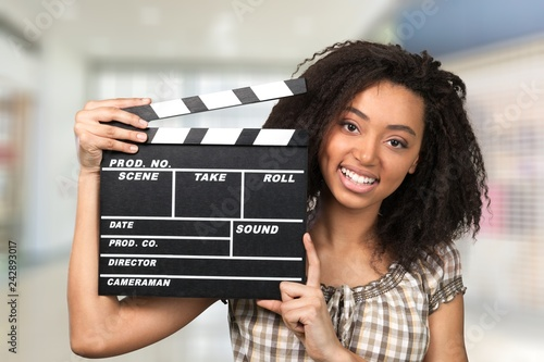 Photo Young woman with movie clapper isolated