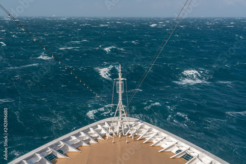 Fotomural View from front at the rough seas and waves forward of bow of cruise ship
