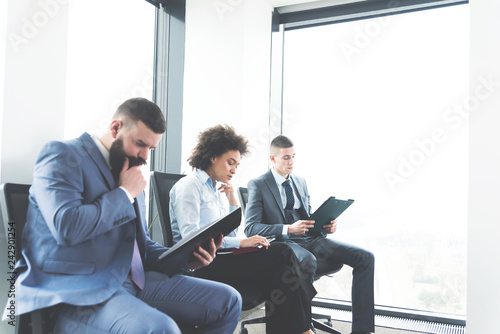 Businesspeople in waiting room for job interview