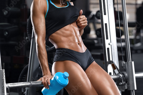 Stampa su Tela Fitness woman showing abs and flat belly