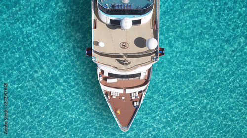 Photo Stands Ship Aerial top view photo of huge liner cruise ship docked in tropical exotic mediterranean bay with turquoise sea