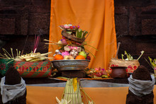 Hindu Offerings At A Temple In Bali, Indonesia. Elaborate Handmade Offerings Are Brought To The Temple And Then Blessed By The Holy Man Or Priest During A Hindu Holiday.