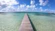Beach with jetty in Caribbean luxury resort Bahamas