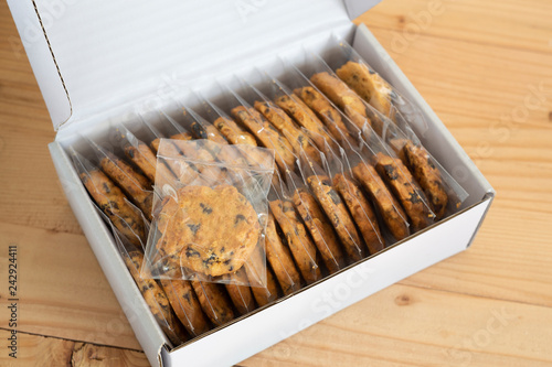 Cookies homemade in plastic wrap package on  paper box.