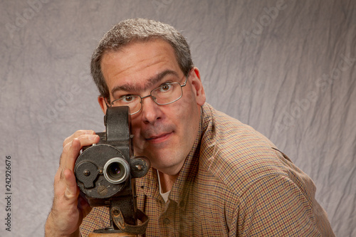 Photo Middle Age Man with vintage movie camera