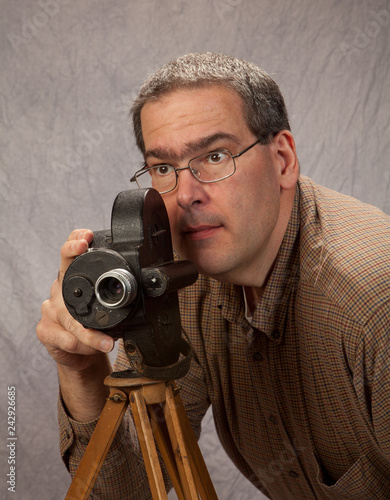 Middle Age Man with vintage movie camera Wallpaper Mural