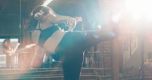 Young Woman Kick Boxing
