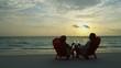 Healthy senior Caucasian couple drinking wine Caribbean paradise