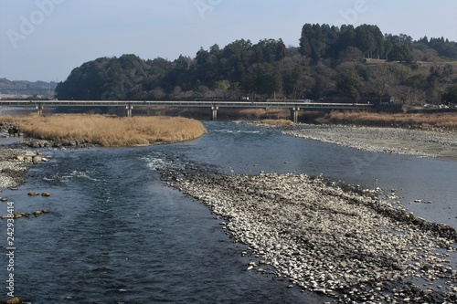 Kuma River flows through the historic town of Hitoyoshi in Japan Poster Mural XXL