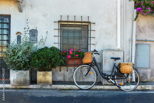 Bicycle with wicker baskets on the street in Orbetello on peninsula in Argentario. Tuscany. Italy