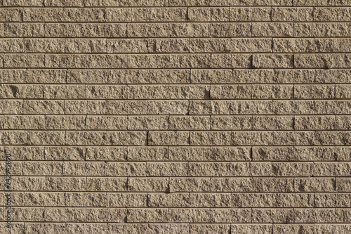Fotografie, Obraz  Rough textured tan brown stone brick wall abstract background