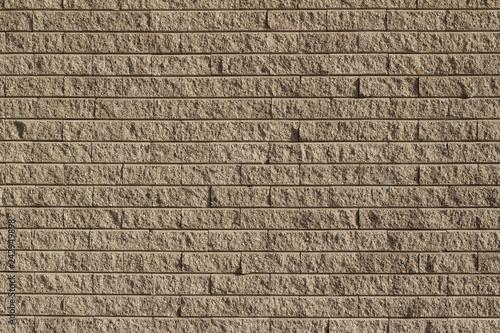 Fotografía  Rough textured tan brown stone brick wall abstract background
