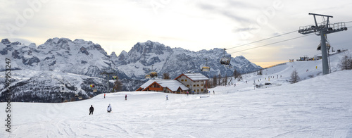 Cuadros en Lienzo ski slopes with skiers at sunset. Trentino, Italy