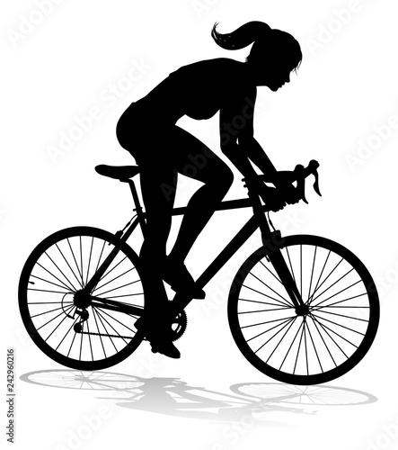 A woman bicycle riding bike cyclist in silhouette Canvas Print