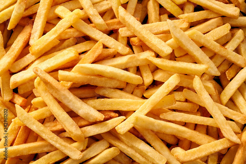 Photo Overhead view of golden deep fried French fries food in full frame closeup