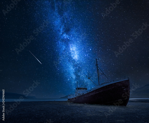 Milky way over a shipwreck on the shore in Iceland