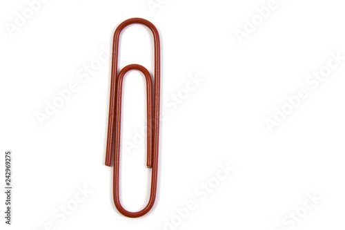 Fotografía  red paper clip isolated on white background