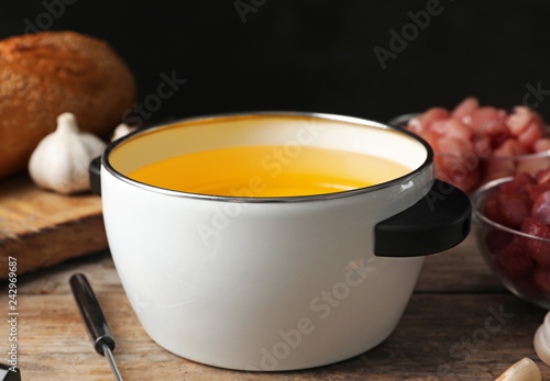 Fotografie, Obraz  Pot with hot oil for meat fondue on table