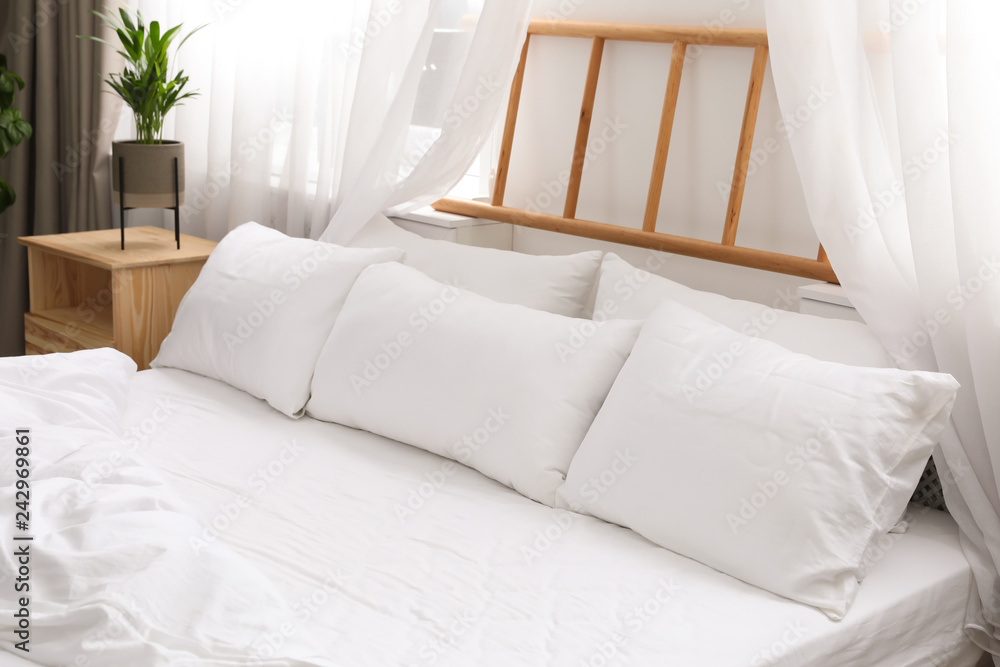 Fototapety, obrazy: Comfortable bed with soft pillows in room interior