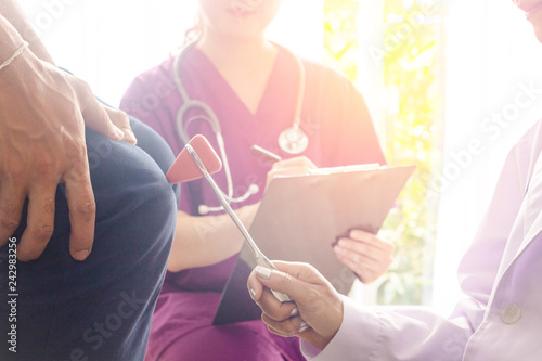 Close – up doctor and male patient Doctor using examining patient