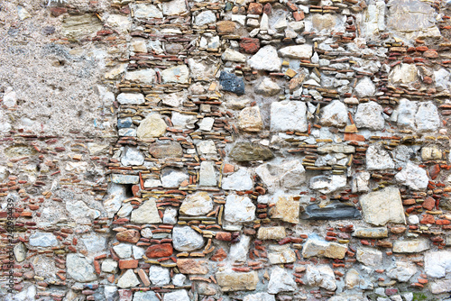 Fotografia, Obraz  Patterns and textures of rock, stones and mortar in vintage street and wall cons