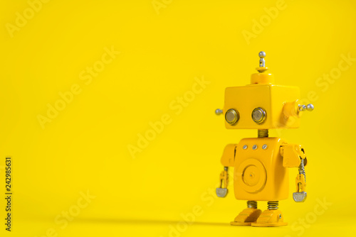 Robot on a yellow background. Canvas Print