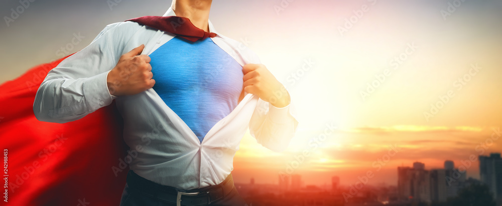 Fototapeta superhero businessman looking at city