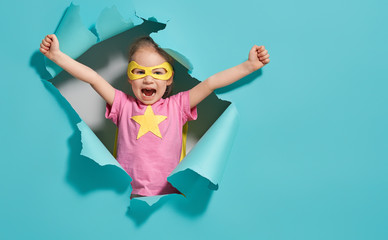 child playing superhero