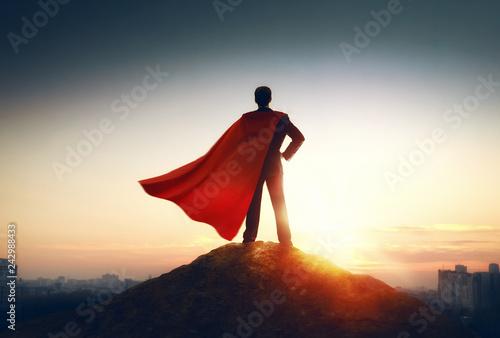Obraz na plátně superhero businessman looking at city