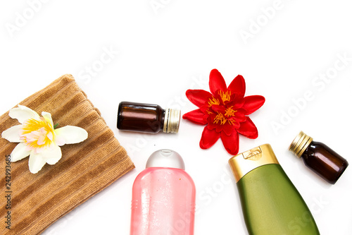 Plastic Bottle Of Body Care Or Shampoo Above Brown Towel Essential