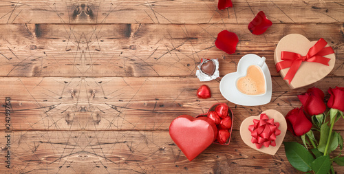 Fotografía  Valentine's day banner with coffee cup, heart shape chocolate, rose flowers and gift boxes on wooden background