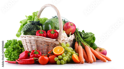 Fresh organic fruits and vegetables in wicker basket - 243006060