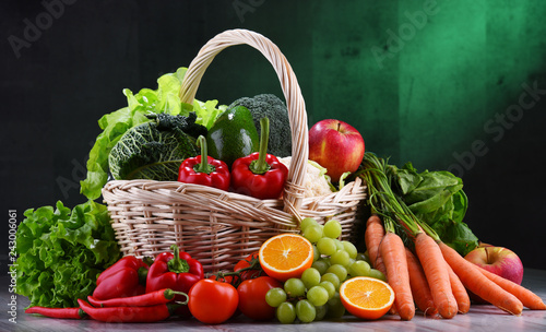 Fototapeta Fresh organic fruits and vegetables in wicker basket obraz na płótnie