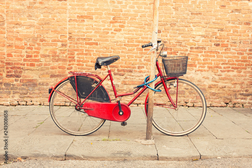 Recess Fitting Bicycle Italian red retro bike parked in the old streets of Siena, Italy.