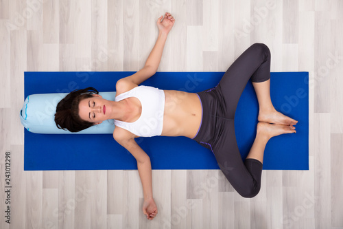 Young Woman Practicing Yoga With Bolster Canvas Print