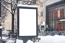 Vertical Mock-up Of City Poster Winter City With Thick Edges, Blank White Billboard In Urban Settings, Empty Street Information Placeholder On Sidewalk With Copy Space For Logo