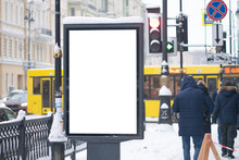 Outdoor Advertising Mockup. On The Street Of A Winter City Under The Snow.