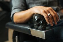 Retro Style Man Sit On The Chair And Hold Skull With Scissors. - Image