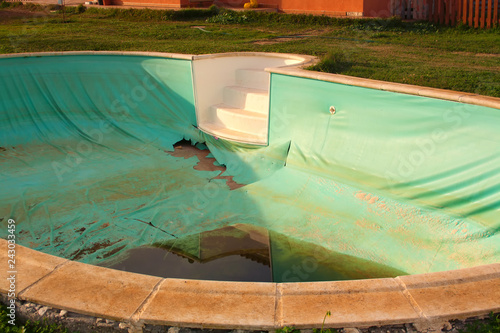 Old abandoned swimming pool with dirty water - Buy this