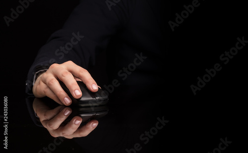 Hand using wireless mouse in a dark environment
