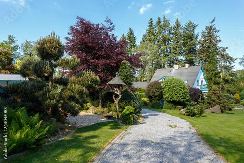 Beautiful Spring Garden Design In Front Bird Feeder And Rural House