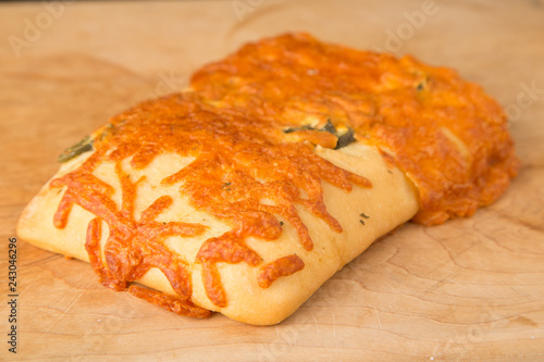 Fotografie, Obraz  Loaf of cheese foccacia bread with jalapenos on cutting board