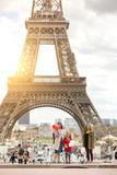 Fototapeta Fototapety z wieżą Eiffla - Mom and daughters on the background of the Eiffel Tower
